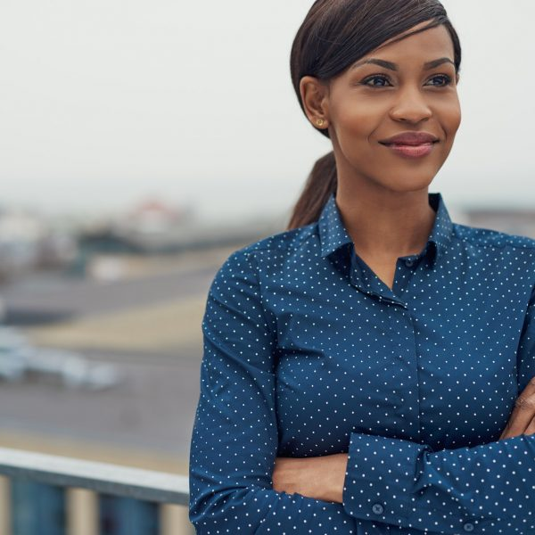 Confident friendly black business woman